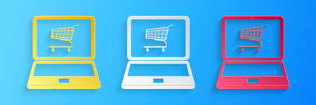 Paper cut Online shopping concept. Shopping cart on screen laptop icon isolated on blue background. Concept e-commerce, online business marketing. Paper art style. Vector