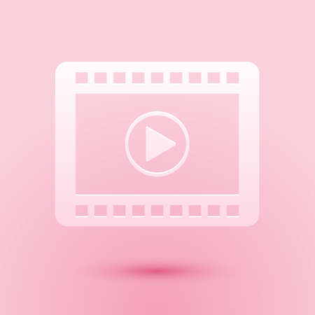 Paper cut Play Video icon isolated on pink background. Film strip with play sign. Paper art style. Vector Illustration