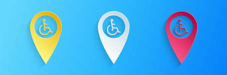 Paper cut Disabled Handicap in map pointer icon isolated on blue background. Invalid symbol. Wheelchair handicap sign. Paper art style. Vector