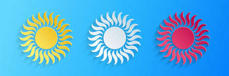 Paper cut Sun icon isolated on blue background. Paper art style. Vector