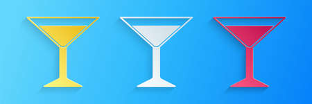 Paper cut Martini glass icon isolated on blue background. Cocktail icon. Wine glass icon. Paper art style. Vector Illusztráció