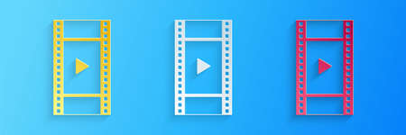 Paper cut Play Video icon isolated on blue background. Film strip with play sign. Paper art style. Vector