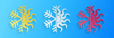 Paper cut Hot and cold symbol. Sun and snowflake icon isolated on blue background. Winter and summer symbol. Paper art style. Vector