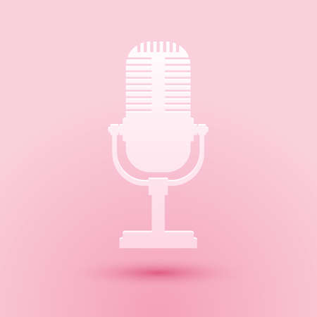 Paper cut Microphone icon isolated on pink background. On air radio mic microphone. Speaker sign. Paper art style. Vector 向量圖像