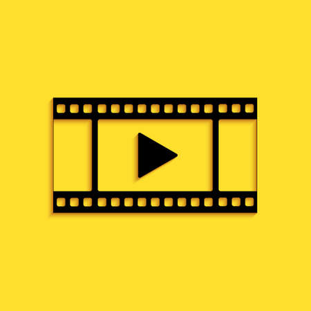Black Play Video icon isolated on yellow background. Film strip with play sign. Long shadow style. Vector