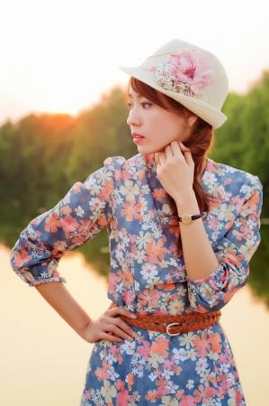 Fashion model at sunrise in white dress  photo