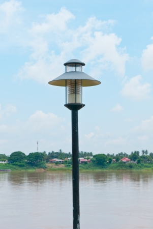 Black metal street-lights along the pier-head alongside the River at NongKhai Thailand Stock Photo - 14411993