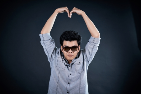love shape hand by Handsome man  photo