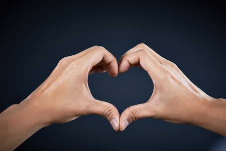 love shape hand by Handsome man Stock Photo - 17958626