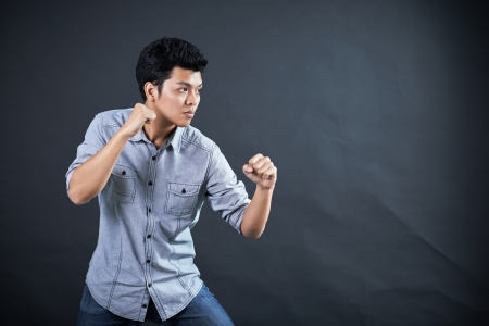Style of fighting in the studio Stock Photo - 17958638