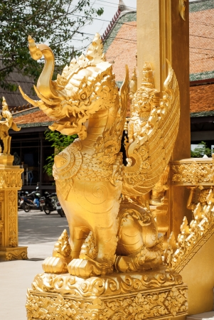 Gold Lion in front of the door before going to the Tample , Thailand photo