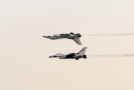 Bangkok, Thailand - October 9, 2009: United States Air Force Thunderbirds official military aerobatic team during an exhibition. The squadron tours the United States and much of the world, performing aerobatic formation and solo flying in specially marked Editorial
