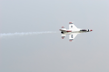 united states air force: Bangkok, Thailand - October 9, 2009: United States Air Force Thunderbirds official military aerobatic team during an exhibition. The squadron tours the United States and much of the world, performing aerobatic formation and solo flying in specially marked Editorial