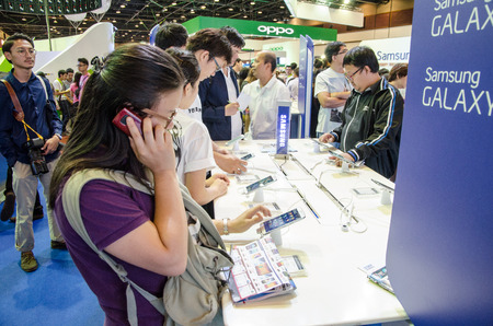 Bangkok, Thailand - February 14, 2014  Panoramic view of people visiting to play mobile at Thailand Mobile Expo 2014 ,Exhibition of Mobile, Information and Communication Technology on February 14-16, 2014 in Bangkok,Thailand