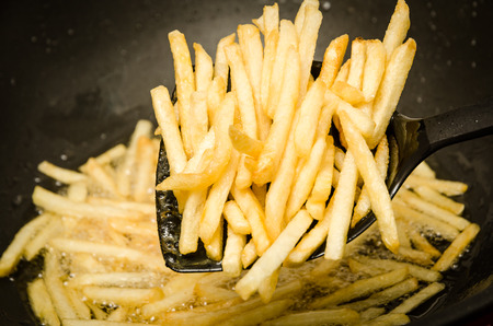 liquid state: French fries in a hot pan.