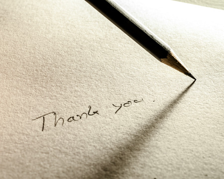 Pencil with paper writing Thank you photo