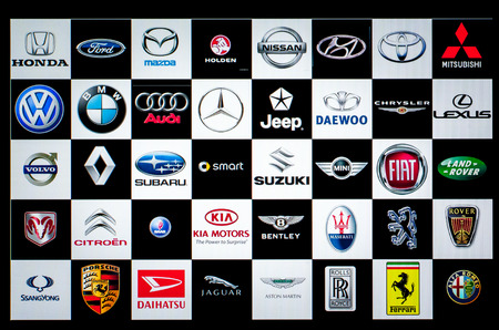 globally: Bangkok, Thailand - March 29, 2014:Vehicle manufacturer logos, photographed on a computer screen. The automotive industry produces and sells vehicles globally, over 70 million were produced in 2010.