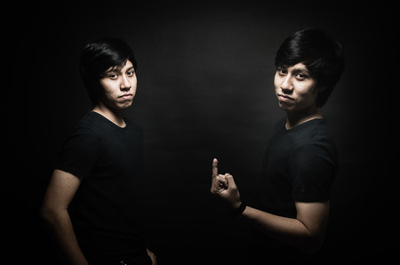 Nice male twins isolated on black background  photo