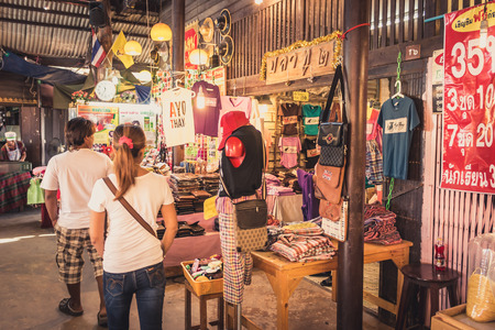 phra nakhon si ayutthaya: Phra Nakhon Si Ayutthaya, Thailand - April 14, 2015: Ayothaya Floating Market. Has a many visitors, both Thais and foreign visitors with varieties of Thai clothes and Thai food at Ayutthaya,Thailand Editorial