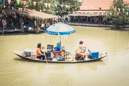Phra Nakhon Si Ayutthaya, Thailand - April 14, 2015: Ayothaya Floating Market. Has a many visitors, both Thais and foreign visitors with varieties of Thai clothes and Thai food at Ayutthaya,Thailand Editorial