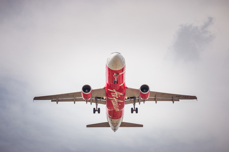 BANGKOK, THAILAND - MAY 20, 2015: HS-ABV Airbus A320-200 of Air Asia landing to Don Mueang International Airport Thailand. Air Asia company is the largest low cost airlines in Asia. Editorial