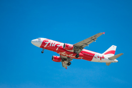asia: BANGKOK, THAILAND - JUNE 1, 2015: HS-BBG Airbus A320-216 of Thai Air Asia landing to Don Mueang International Airport Thailand. Thai Air Asia company is the largest low cost airlines in Asia.