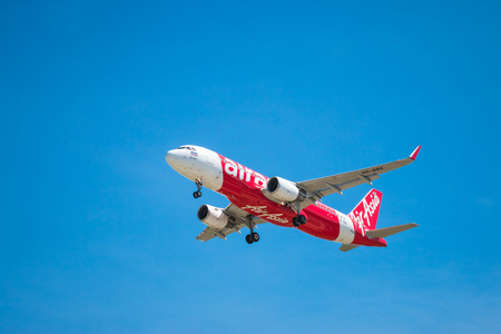 BANGKOK, THAILAND - JUNE 1, 2015: HS-BBG Airbus A320-216 of Thai Air Asia landing to Don Mueang International Airport Thailand. Thai Air Asia company is the largest low cost airlines in Asia.