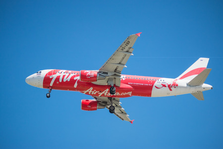 BANGKOK, THAILAND - JUNE 1, 2015: HS-ABP Airbus A320-216 of AirAsia landing to Don Mueang International Airport Thailand. AirAsia company is the largest low cost airlines in Asia.