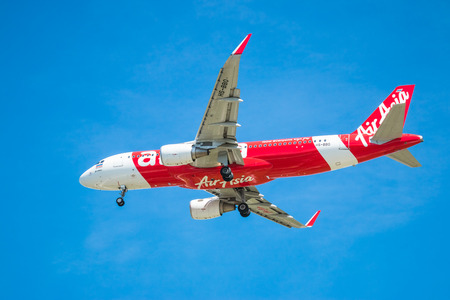 suvarnabhumi: BANGKOK, THAILAND - JUNE 1, 2015: HS-BBO Airbus A320-216 of Thai Air Asia landing to Don Mueang International Airport Thailand. Thai Air Asia company is the largest low cost airlines in Asia.