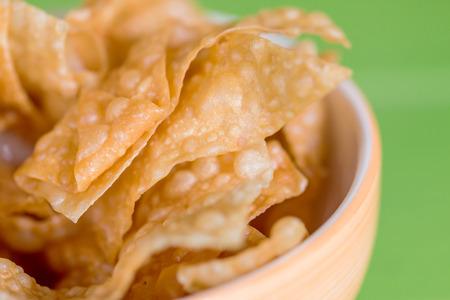 prepared food: Thai and Asian Style food appetizer Deep Fried Wonton or dumplings