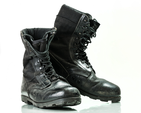 military boots: Black old combat military boots isolated on white background Stock Photo