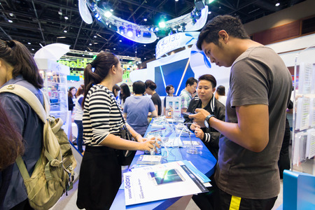 sirikit: BANGKOK, THAILAND - October 3, 2015 :Thailand Mobile Expo 2015 Showcase The largest Event Mobile in the country Between 1-4 October 2015, The public are interested in attending the event are numerous at The Queen Sirikit National Convention Center. Editorial