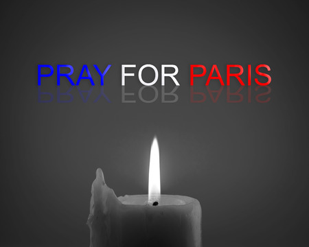 rampage: Pray for Paris 13 November 2015, Candle light with  France flag and message.