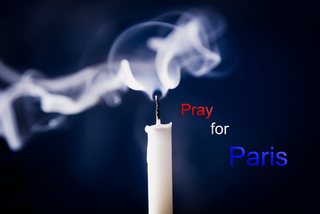 Pray for Paris 13 November 2015, Candle light with  France flag and message.