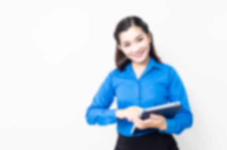 blur effect: Blur effect of image of a young woman with a lovely look and charming smile in blue shirt