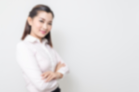 blur effect: Blur effect of portrait of smiling business woman, isolated on white background Stock Photo
