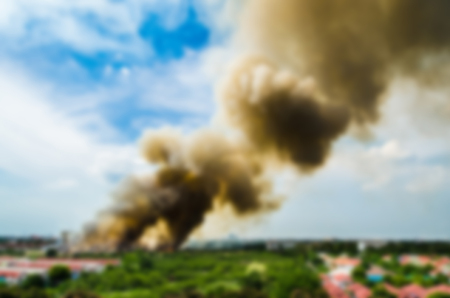 blur effect: Blur effect of Forest fires in the city, causing a large flame and smoke in the air is very hot days. Firemen rush to help prevent the spread of fire to the village Stock Photo