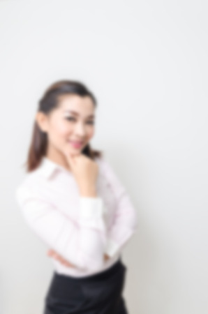 Blur effect of portrait of smiling business woman, isolated on white background Stock Photo