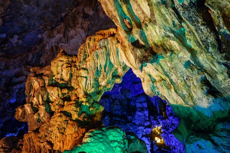 Colorful inside of Hang Sung Sot cave in Halong Bay, Vietnam Stock Photo
