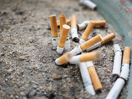 Bangkok, Thailand - May 25, 2018:The cigarette butts are left on a small sand tray. In the smoking area Smoking is a risk to ones own health and others.