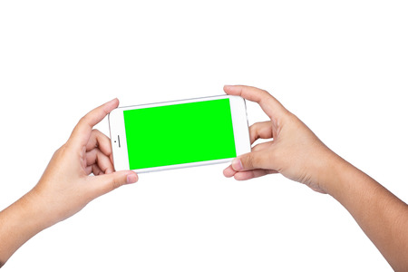 Hand holding a modern mobile smart phone with blank green screen isolated copy space on white background