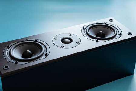 Closeup of black premium loudspeaker for music and home theater system with color mood and tone style