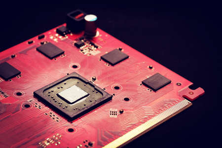 The vintage of chipset digital on red board and black background with a light focus Stock Photo