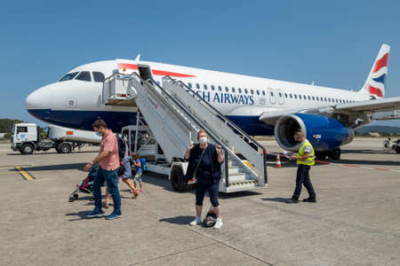 Preveza. Greece- 07.25.2021: passengers arriving at Aktion Airport for the start of their summer holiday.