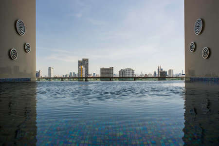 Skyline cityscape view from infinity edge swimming pool photo