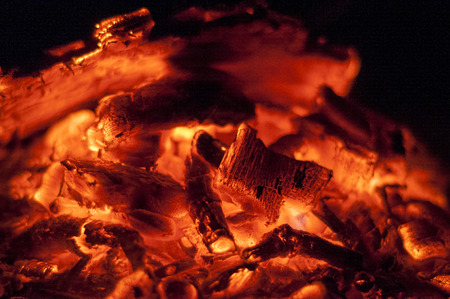 Burning wood makes a texture on coal. Reklamní fotografie
