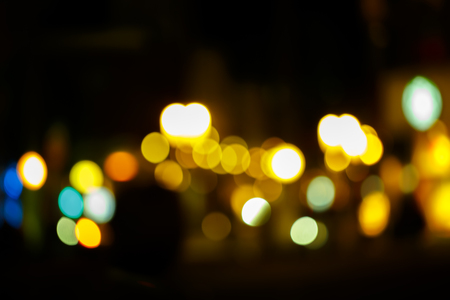 Sparkle Night life light bokeh. Sparkle Yellow and blue and green bokeh of light with black background.