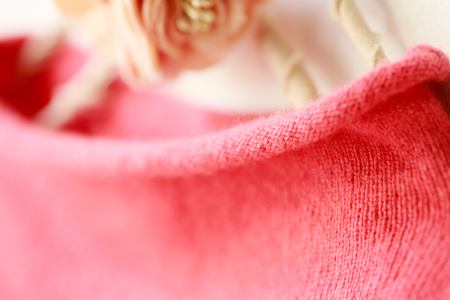Beautiful, luxurious, knitted high neck sweater in pink, autumn, winter, warm. Archivio Fotografico