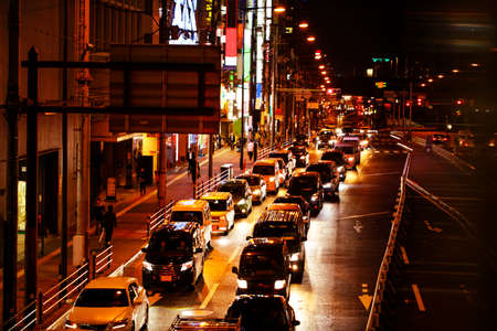 Lights of car traffic on a busy City road at night in the big city.