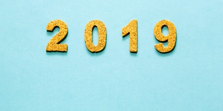 New years resolution 2019 concept. cork year number on light blue color background with copy space for your text